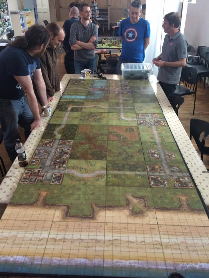 1) The table takes shape, 40 boards used , 3000 points Allies and 1500 for the axis. Here you can se the two towns near the beach head, these were objectives the allies had to take. the middle village on the right was another and finally Pegasus Bridge.