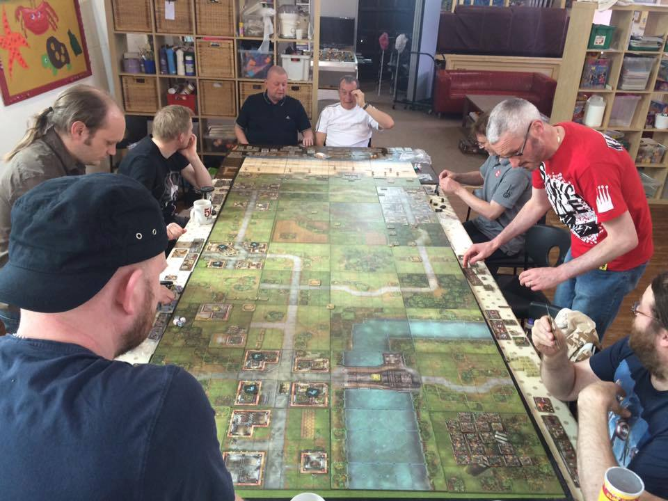 3) The 10 player game starts, the sides take position, let battle commence! Each side had a command board which enabled us to purchase extra benefits for each side.Each player got to chose a hero character which represented themselves.